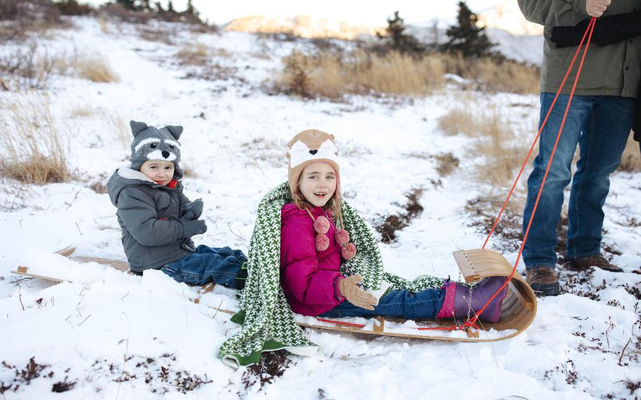 Jase, 3, and Emma, 6, who both get daily therapies for speech and behavior, sled in November 2017 near their home  in Anchorage, Alaska, where their father, an airman is based at Joint Base Elmendorf Richardson. Their mother Jeri Romesha used her health care contacts on base to help save their therapy services when Tricare problems emerged.