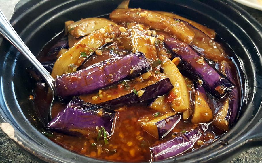 Sliced eggplant in a spicy garlic sauce has a sweet-and-sour taste and can serve as a welcome reprieve from the hotter fare at Chengdu Taste in Honolulu.