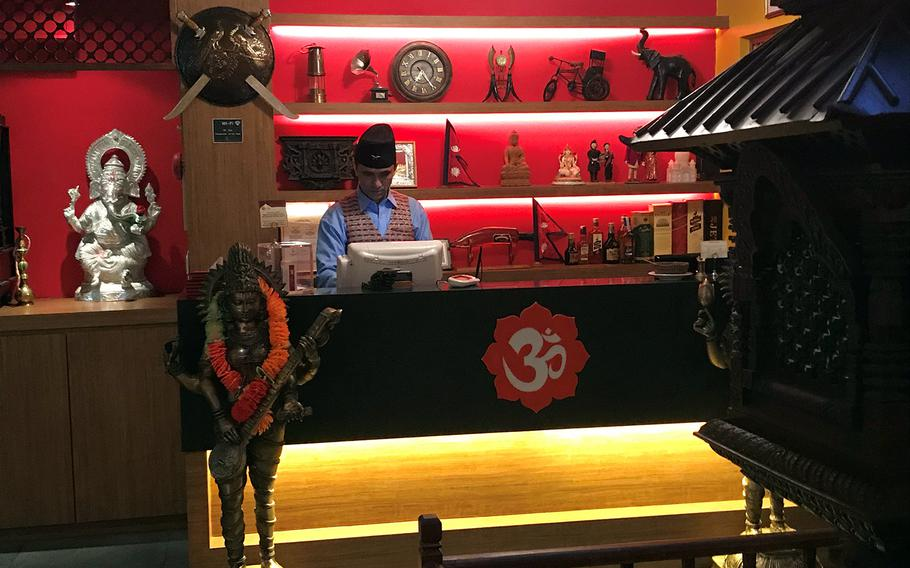 The decor at Om in Seoul, South Korea, features lattice wood carvings, imported wall hangings, elephant statues and other exotic decorations.