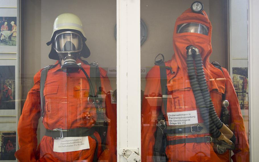 Mining safety clothing and breathing equipment.