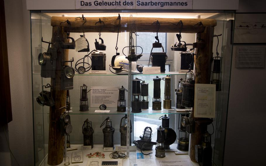 A mining museum's collection wouldn't be complete without a display case of lighting equipment.