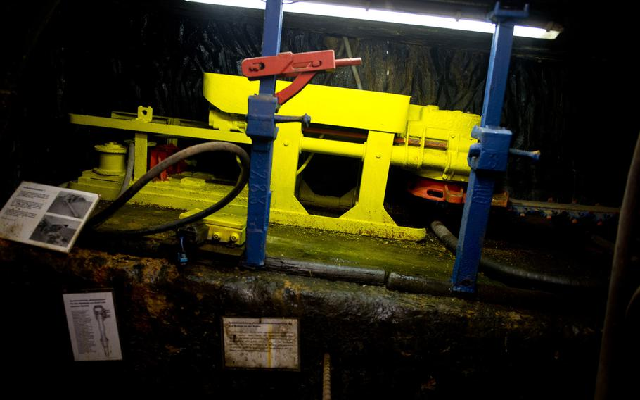 Coal extraction equipment is set up to demonstrate how it would have been used during mining operations.