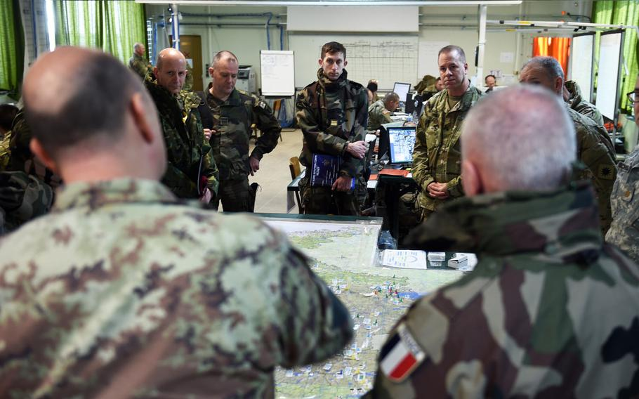 Senior leaders with U.S. and NATO allies discuss strategy during Exercise Citadel Guibert at Mourmelon-le-Grand, France, Wednesday, March 21, 2018.