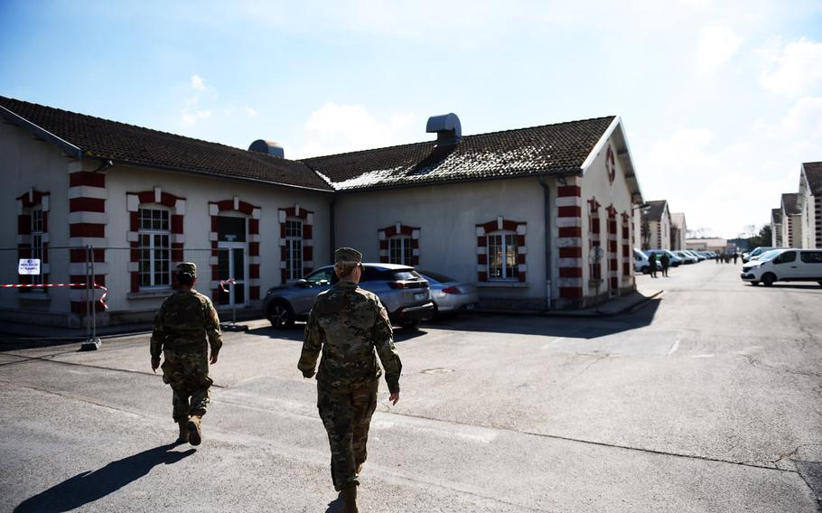California National Guardsmen walk towards the French Army chow hall at Mourmelon-le-Grand, France, Wednesday, March 21, 2018.