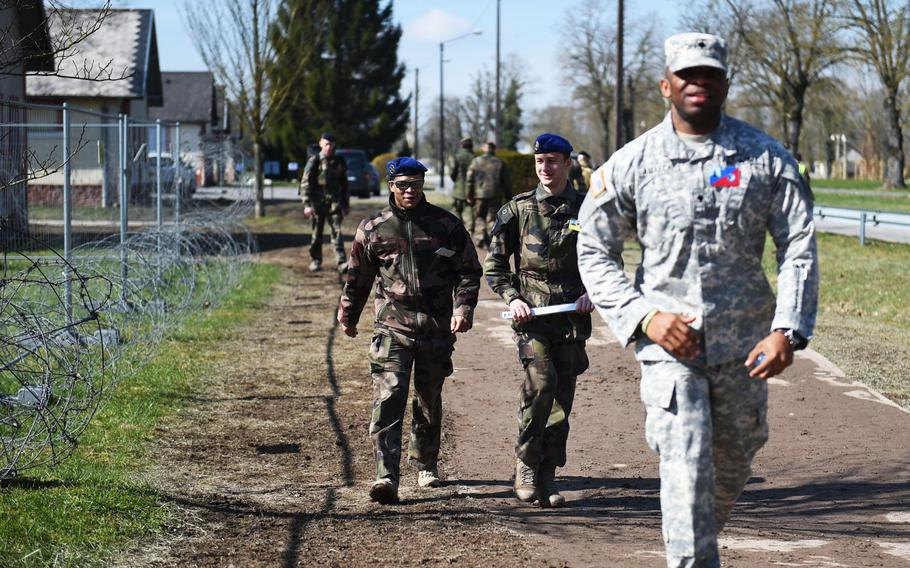 French and U.S. soldiers walk during Exercise Citadel Guibert at Mourmelon-le-Grand, France, Wednesday, March 21, 2018.