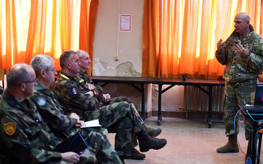 Brig. Gen. Mark Malanka, commander of the 40th Infantry Division, goes over his strategy with NATO commanders during Exercise Citadel Guibert, Wednesday, March 21, 2018.
