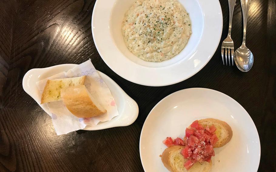 Creamy chicken risotto, bruschetta and garlic bread at Joy Cook, an Italian restaurant near Camp Humphreys in Pyeongtaek, South Korea.