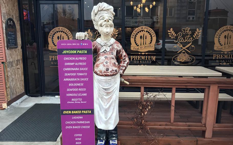 A baker statue welcomes diners to Joy Cook, an Italian eatery near Camp Humphreys, South Korea.