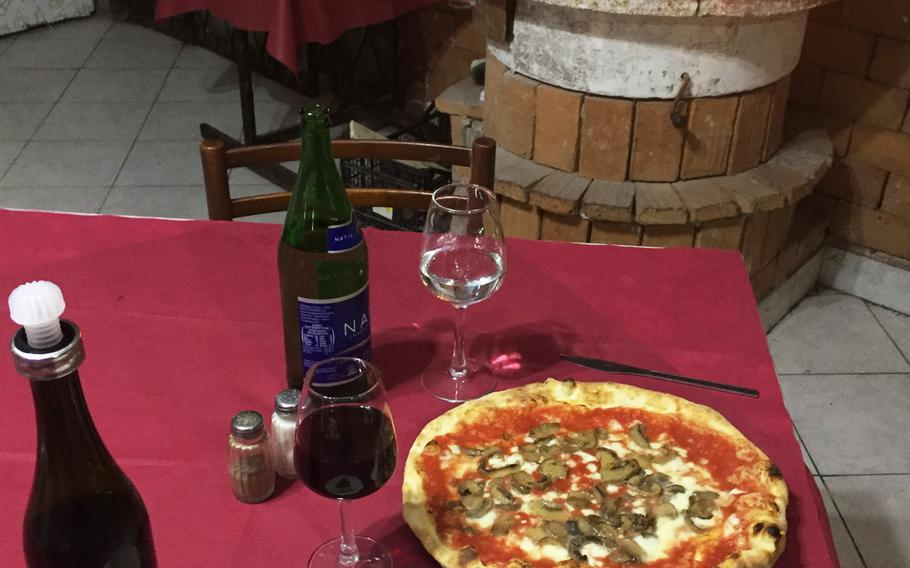 A fire crackling in a marble hearth creates a warm atmosphere while you dine at  Ristorante Pizzeria Il Pentolone. Located in the Parco Azzurro apartment complex, it is off the beaten path in Pozzuoli, Italy.