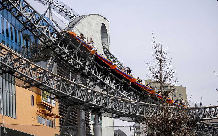 Passengers scream as they zoom past an on-ride photo section at Thunder Dolphin, a 90-second powerhouse of a roller coaster at Tokyo Dome City Attractions in the heart of Tokyo.