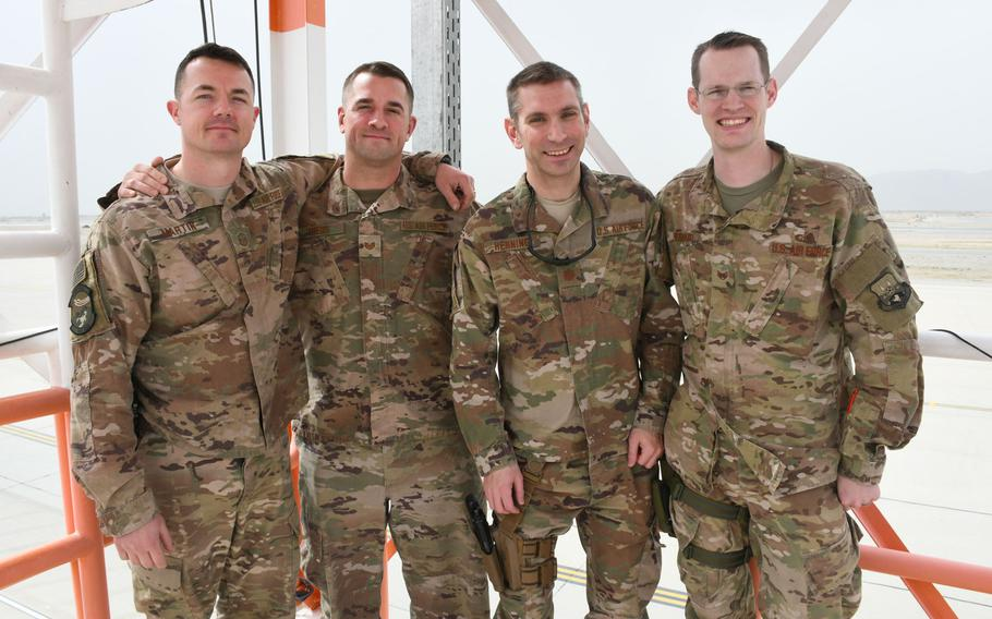 Members of the 451st Expeditionary Operations Support Squadron's meteorological team pose for a photo on their observation deck at Kandahar Air Field, Afghanistan, on March 19, 2018. Pictured are from left are Air Force Master Sgt. Dominick Martin, Tech. Sgt. Michael Theos, Maj. William Henning and Staff Sgt. Timothey Everhard.