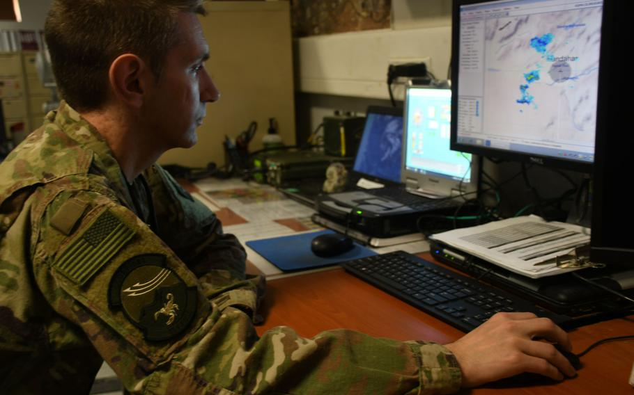 Air Force Maj. William Henning, flight commander of the 451st Expeditionary Operations Support Squadron's meteorological team, analyzes the weather in his office at Kandahar Air Field, Afghanistan, on March 19, 2018.