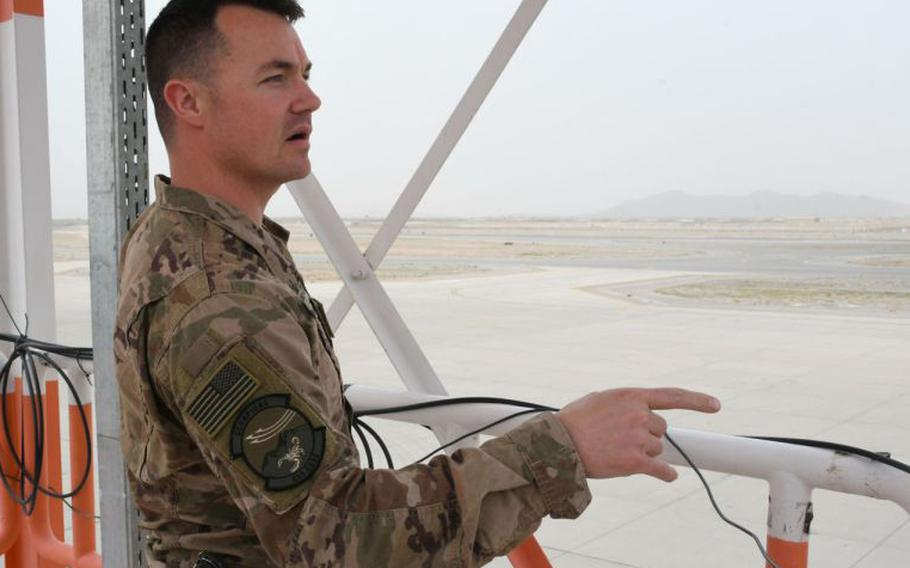 Air Force Master Sgt. Dominick Martin, flight chief of the 451st Expeditionary Operations Support Squadron's meteorological team, observes the weather from the group's observation deck at Kandahar Air Filed, Afghanistan, on March 19, 2018.