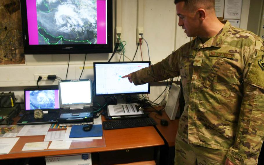 Air Force Tech. Sgt. Michael Theos of the 451st Expeditionary Operations Support Squadron's meteorological team analyzes the weather in his office at Kandahar Air Filed, Afghanistan, on March 19, 2018.