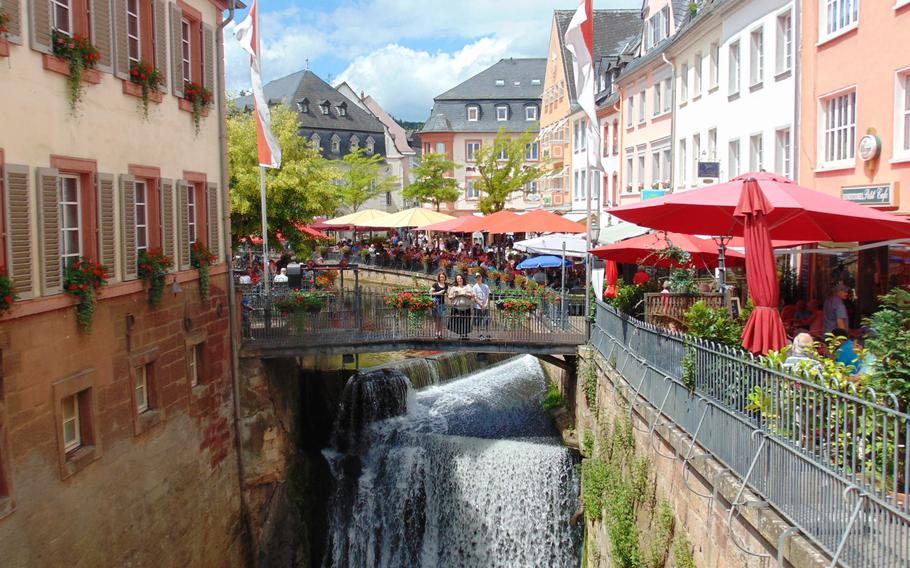 A narrow bridge spans the waterfall at the center of Saarburg, Germany. The roughly 60-foot waterfall gives the routinely picturesque town a distinctive centerpiece.