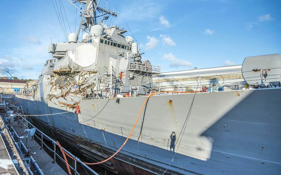 The collision-damaged guided-missile destroyer USS Fitzgerald sits in dry dock at Yokosuka Naval Base, Japan, July 11, 2017.