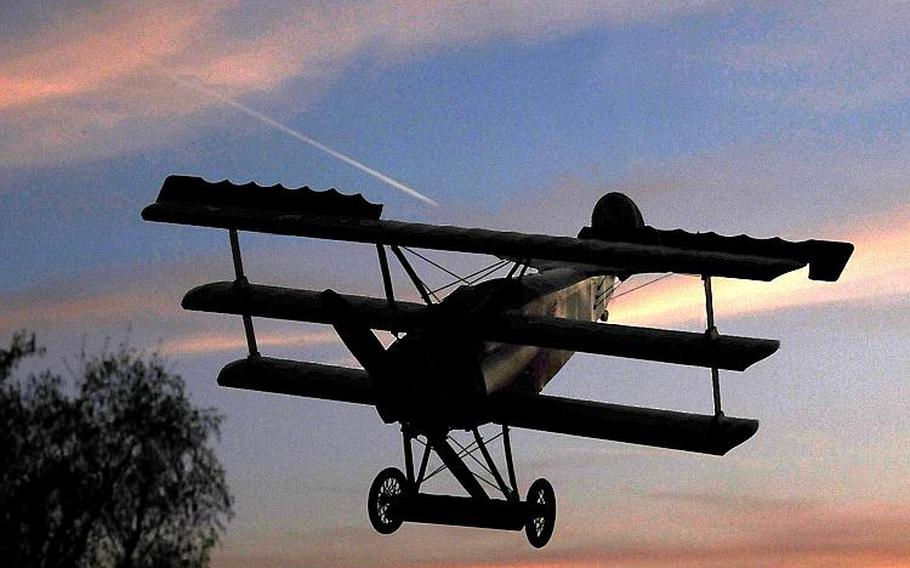This is a model of Manfred von Richthofen's famous Dr.I triplane, photgraphed in front of the evening sky over Wiesbaden, commemorating the 100th anniversary of the death of the Red Baron in 1918 in France.