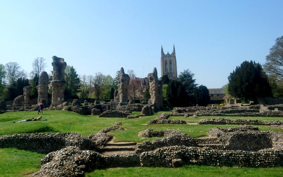 The ruins of an 11th-century Benedictine Abbey inside the Abbey Gardens in Bury St. Edmunds, England. The abbey was damaged by rioting townspeople in 1327 and stripped of its valuable building materials when it was surrendered to King Henry VIII in 1539, after his break with the Catholic Church.