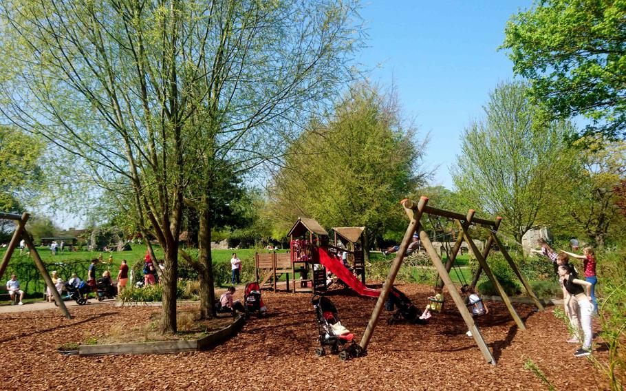 Children can play in a special area at the Abbey Gardens in Bury St. Edmunds, England. The 14-acre park also features a rose garden, wildlife feeding area, a small aviary with a variety of birds, an herb garden, a sensory garden for the blind, a bowling green and a tennis court.