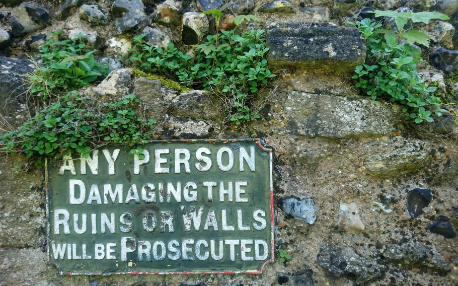 Visitors are warned about damaging what's left of a wall from the 11th-century Benedictine Abbey ruins at the Abbey Gardens in Bury St. Edmunds, England. The Great Gate at the main entrance to the park is the best-preserved feature, with intact stonework from the 14th century.