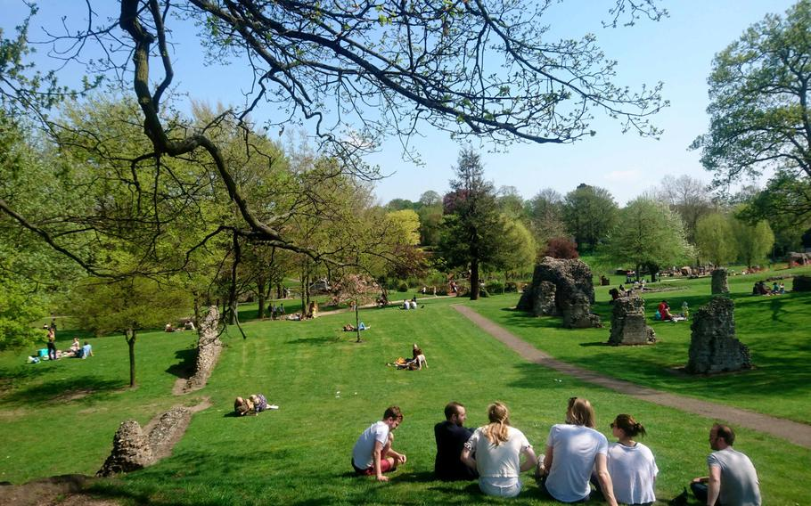 Visitors enjoy a sunny afternoon at the Abbey Gardens in Bury St. Edmunds, England. For the past nine years the Abbey Gardens has earned the Green Flag Award Scheme, an international mark of quality for parks and green space.