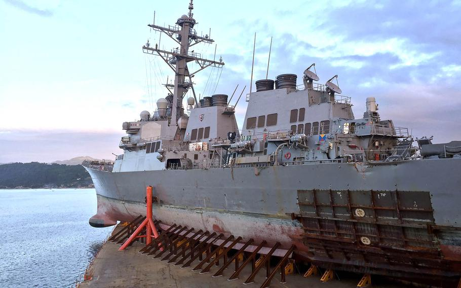 The guided-missile destroyer USS John S. McCain departs Subic Bay, Philippines, aboard heavy lift transport vessel MV Treasure, Nov. 28, 2017.