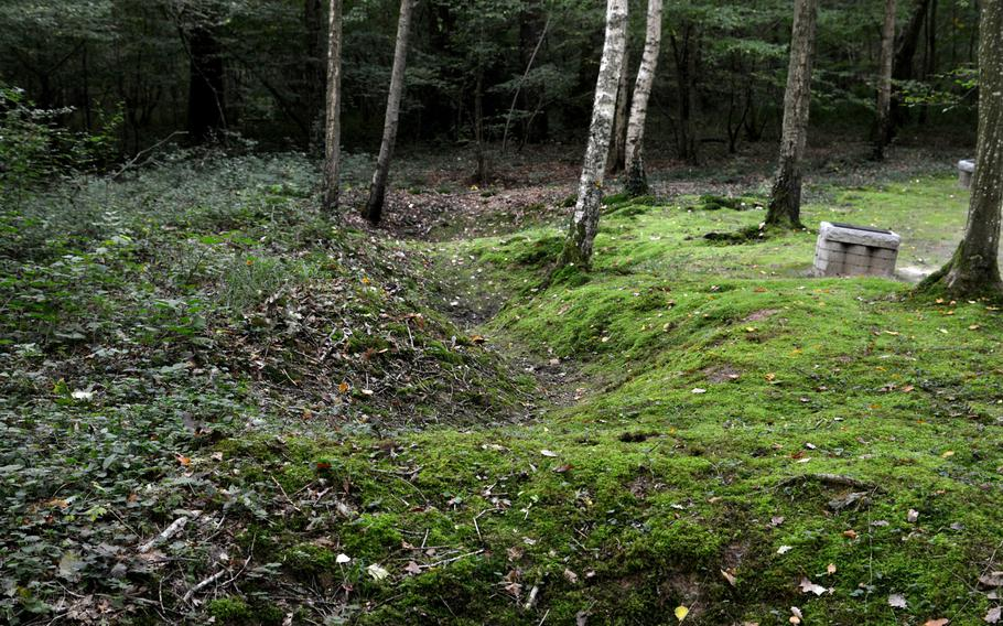 One hundred years later, vestiges of shell holes, trenches and weapons can be seen on the Belleau Wood battlefield near the Marine Monument.