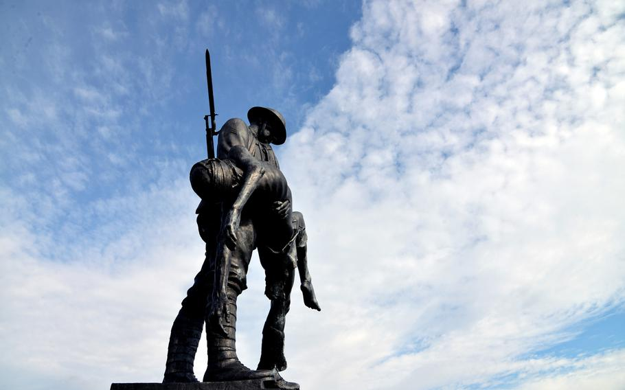 The Rainbow Division Memorial near Fere-en-Tardenois, France. The memorial, where the 42nd - Rainbow - Division fought the battle of Croix Rouge Farm in World War I, features a bronze statue of an American soldier carrying his dead comrade. It is the work of British artist James Butler.