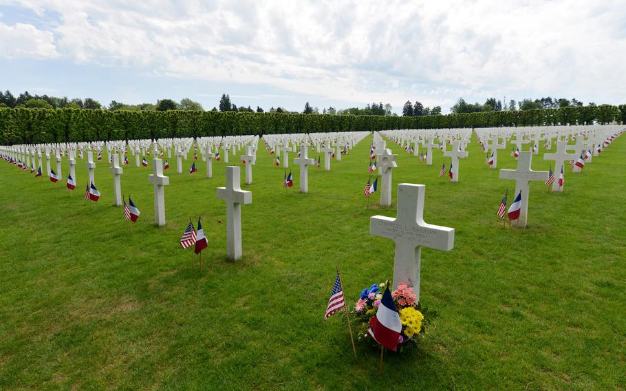 Graves at Meuse-Argonne American Cemetery, decorated with American and French flags for Memorial Day. The cemetery is the largest administrated by the American Battle Monuments Commission in Europe.