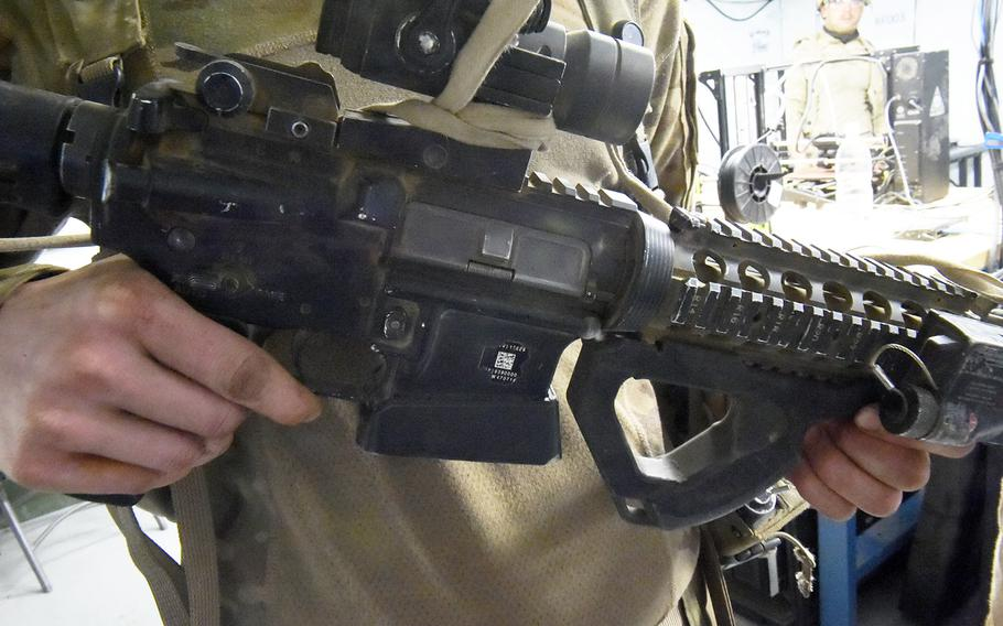 An M4 assault rifle with 3D-printed magazine well and foregrip made with the Rapid Fabrication via Additive Manufacturing 3D-printing unit, Hohenfels, Germany, Tuesday, May 8, 2018.