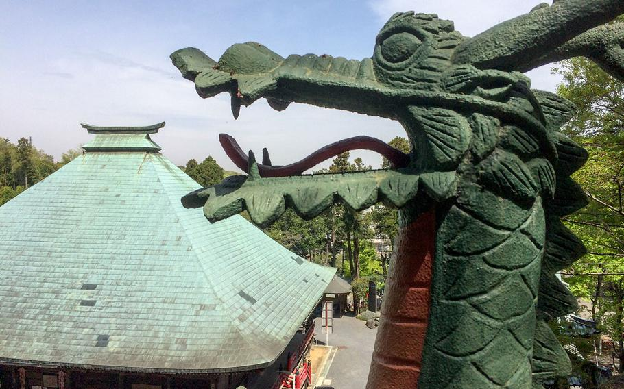 Carved dragons, which become giant thanks to forced perspective, accessorize staircases at the Yamaguchi Kannon temple in Kamiyamaguchi.