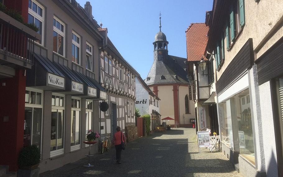 A typical street in Oberursel, Germany's old city, leading to the Hospital Church, seen in the center background. Oberursel, about 20 minutes north of Frankfurt, boasts a rich history and nearby hiking and mountain biking trails through the wooded Taunus mountains.
