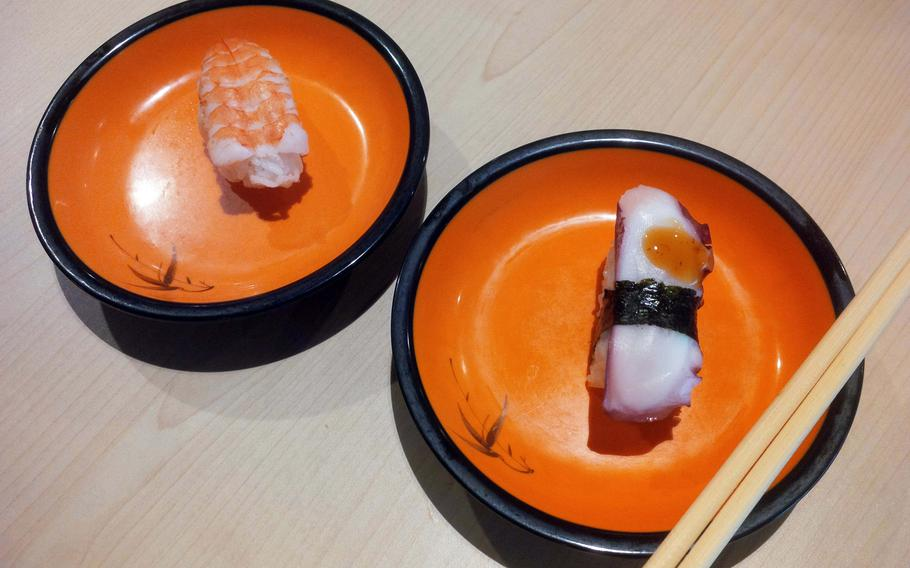 Not all sushi is raw. Two classic options, cooked shrimp and cooked octopus, on offer at Aki Running Sushi, an all-you-can-eat sushi restaurant at K in Lautern in Kaiserslautern, Germany.