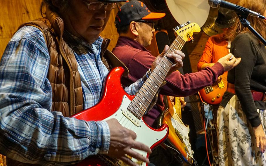 Taku Murakami plays guitar during a blues and rock session at Cafe de Noel March 23, 2018.