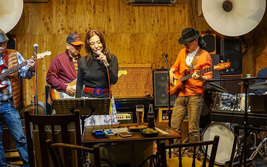 A band plays at the Cafe de Noel, a live music venue near Yokota Air Base, Japan, March 23, 2018.