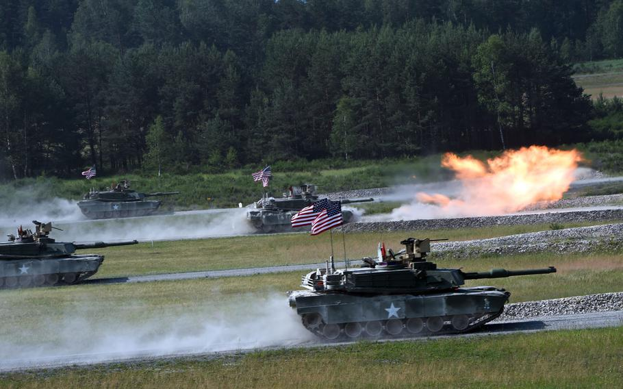 The U.S. tank team fires at targets from its M1A2 Abrams tanks during the Strong Europe Tank Challenge in Grafenwoehr, Germany, Friday, June 8, 2018.