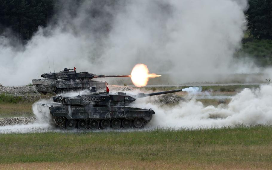 The German tank team fires at targets from its Leopard 2A6 tanks during the Strong Europe Tank Challenge in Grafenwoehr, Germany, Friday, June 8, 2018.