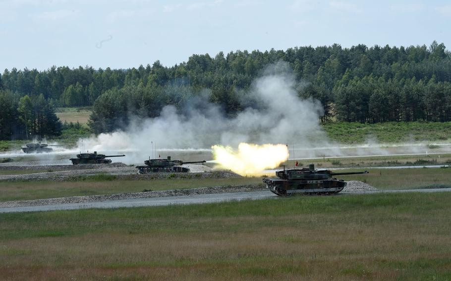 The French tank team fires at targets from its Leclerc tanks during the Strong Europe Tank Challenge in Grafenwoehr, Germany, Friday, June 8, 2018.