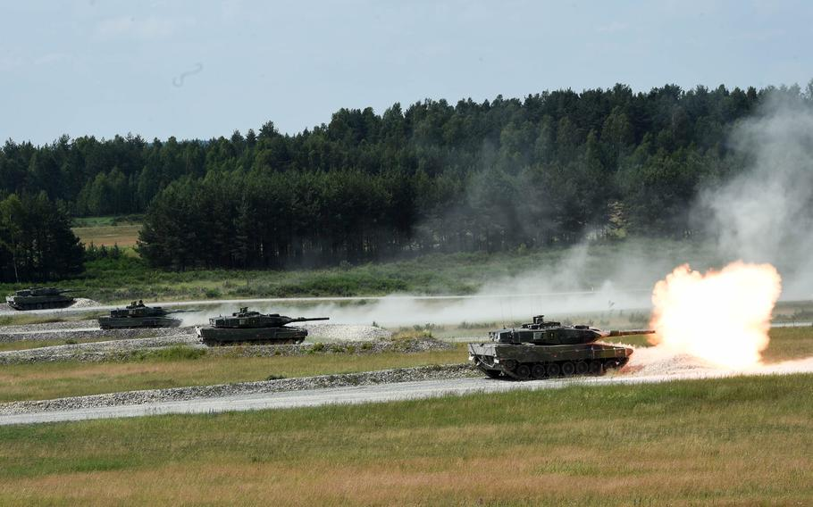 The Swedish tank team fires at targets from its Stridsvagn 122 tanks during the Strong Europe Tank Challenge on Grafenwoehr, Germany, Friday, June 8, 2018.