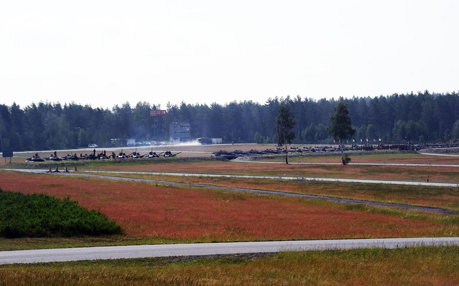 A row of the 32 tanks from eight nations compete at the Strong Europe Tank Challenge in Grafenwoehr, Germany, Friday, June 8, 2018.