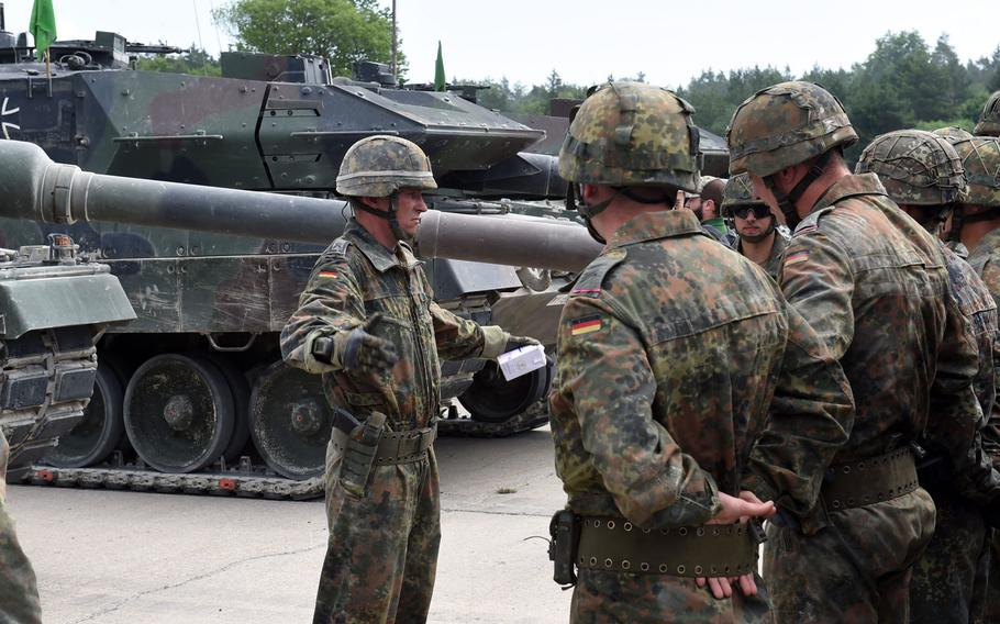 A German tank commander addresses his soldiers during the Strong Europe Tank Challenge its Grafenwoehr, Germany, Thursday June 7, 2018.