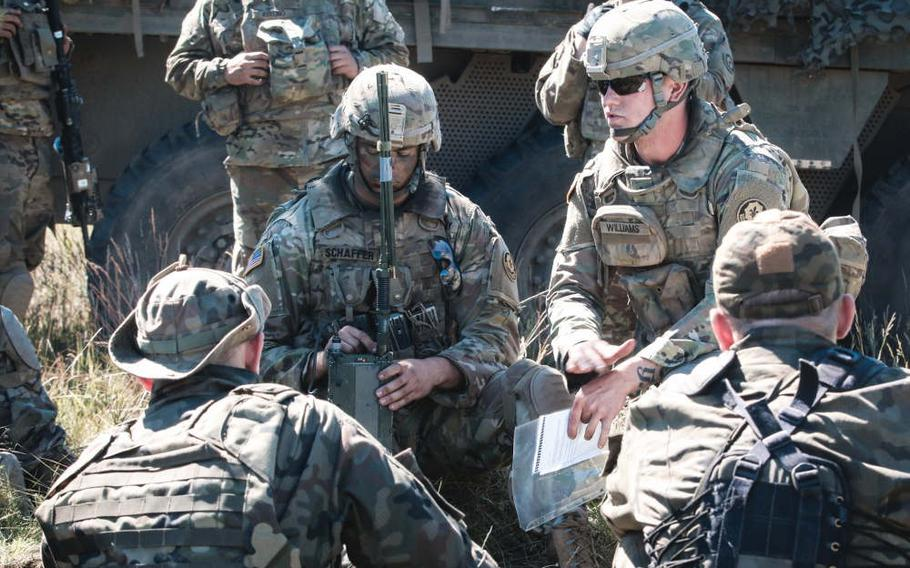 Army Pvt. Jacob Williams, right, with the 1st Squadron, 2nd Cavalry Regiment, teaches Polish soldiers how to use a Single Channel Ground and Airborne Radio System during the Saber Strike exercise at Wyreby, Poland, on June 7, 2018. The U.S. Senate approved a measure last week that would call on the Pentagon to consider the feasibility of permanently deploying U.S. troops to Poland to counter Russian aggression.