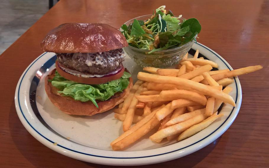"""The Broccoli Grill in Iwakuni offers many great burgers to patrons. Featured here is the """"Chili Burger,"""" which has the traditional American fixings, topped with sauce and freshly cut spicy red peppers."""