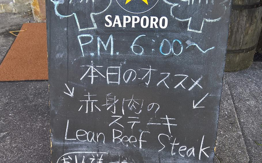 The small sandwich board outside The Broccoli Grill in Iwakuni offers the daily specials.