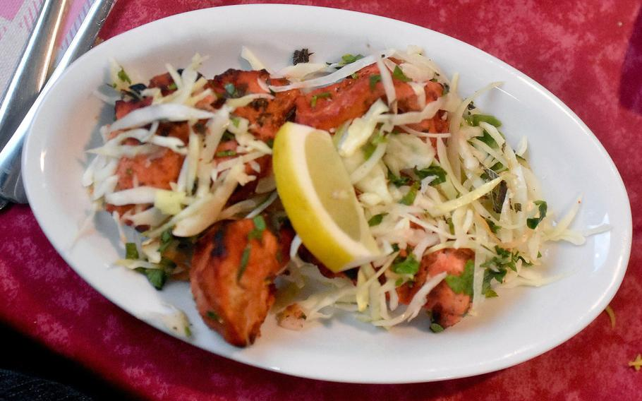 Chicken tikka tandoor at Ristorante Shahi Qila in Sacile, Italy, features chunks of spicy chicken and cabbage.