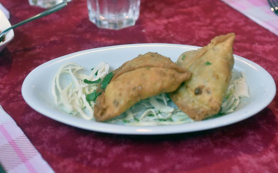 Sabzi Samosa features potatoes and other vegetables surrounded by batter at Ristorante Shahi Qila in Sacile, Italy.