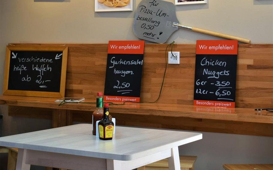 Italian Style Pizza & Pasta in Kaiserslautern, Germany, makes visitors comfortable with a clean, attractive dining room featuring free phone-charging stations.