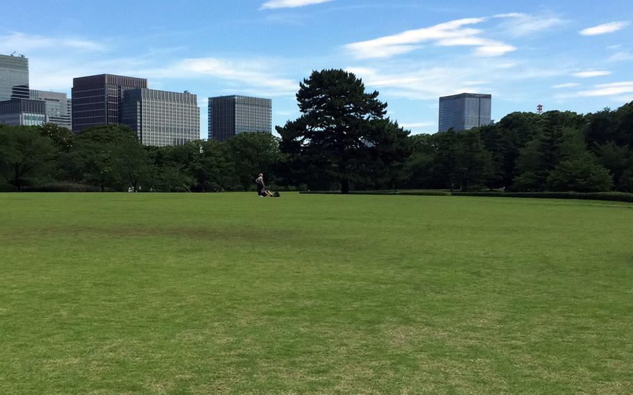 Visitors to The East Gardens inside the Imperial Palace grounds in Tokyo, Japan, enjoy the vast green grounds in a sea of skyscrapers.