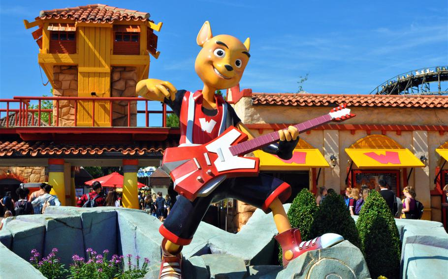 Walibi Belgium's guitar-playing mascot, who shares the name Walibi, welcomes visitors to the park with a statue just inside the front gate.