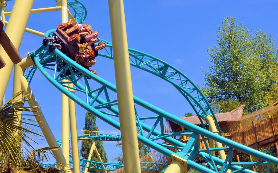 The brightly colored tracks of family roller coaster Tiki Waka wind through Walibi Belgium, a theme park near Brussels, Belgium.